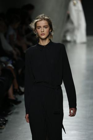 supermodel: MILAN, ITALY - SEPTEMBER 20: A model walks the runway during Bottega Veneta show as a part of Milan Fashion Week Womenswear SpringSummer 2015 on September 20, 2014 in Milan, Italy