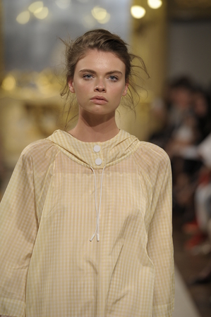 swept: MILAN, ITALY - SEPTEMBER 18: A model walks the runway during the Cristiano Burani show as part of Milan Fashion Week Womenswear SpringSummer 2015 on September 18, 2014 in Milan, Italy.