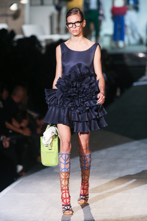 MILAN, ITALY - SEPTEMBER 18: A model walks the runway during the DSquared2 show as a part of Milan Fashion Week Womenswear SpringSummer 2015 on September 18, 2014 in Milan, Italy.