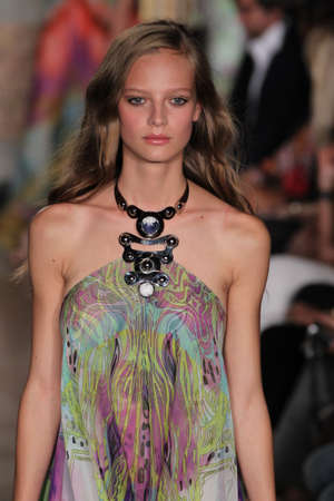 supermodel: MILAN, ITALY - SEPTEMBER 20: A model walks the runway at the Emilio Pucci show as a part of Milan Fashion Week Womenswear SpringSummer 2015 on September 20, 2014 in Milan, Italy.