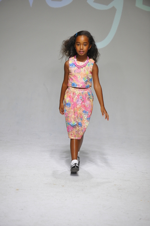 bathhouse: NEW YORK, NY - OCTOBER 18: A model walks the runway during the preview at petitePARADE  Kids Fashion Week at Bathhouse Studios on October 18, 2014 in New York City.