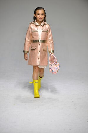 bathhouse: NEW YORK, NY - OCTOBER 18: A model walks the runway during the Oil & Water preview at petitePARADE  Kids Fashion Week at Bathhouse Studios on October 18, 2014 in New York City. Editorial