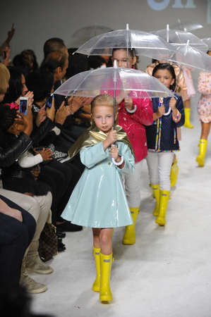 bathhouse: NEW YORK, NY - OCTOBER 18: Models walk the runway during the Oil & Water preview at petitePARADE  Kids Fashion Week at Bathhouse Studios on October 18, 2014 in New York City.