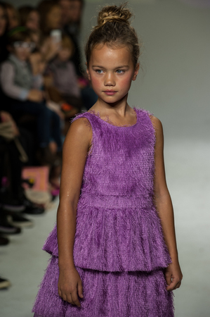 bathhouse: NEW YORK, NY - OCTOBER 19: A model walks the runway during the Ruum preview at petitePARADE  Kids Fashion Week at Bathhouse Studios on October 19, 2014 in New York City. Editorial