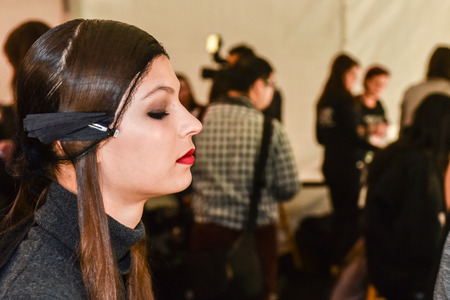 gunmetal: NEW YORK, NY - FEBRUARY 13: A model getting ready backstage at the Monique Lhuillier fashion show during MBFW Fall 2015 at Lincoln Center on February 13, 2015 in NYC