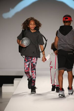 nike: NEW YORK, NY - FEBRUARY 12: Models walk the runway at the Nike Levis Kids fashion show during Mercedes-Benz Fashion Week Fall 2015 at Lincoln Center on February 12, 2015 in NYC