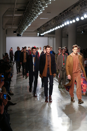 perry: NEW YORK, NY - FEBRUARY 12: Models walk the runway wearing Perry Ellis Fall 2015 at Metropolitan West on February 12, 2015 in New York City.