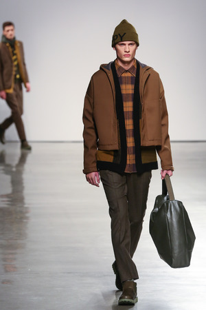 perry: NEW YORK, NY - FEBRUARY 12: A model walks the runway wearing Perry Ellis Fall 2015 at Metropolitan West on February 12, 2015 in New York City.