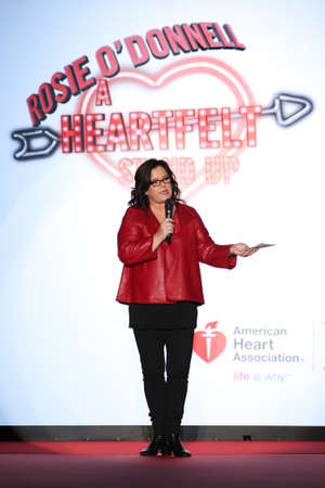 NEW YORK, NY - FEBRUARY 12: Rosie O'Donnell speaks onstage on the runway at the Go Red For Women Red Dress Collection 2015 presented by Macy's fashion show during MBFW Fall 2015 at Lincoln Center on February 12, 2015 in NYC 新聞圖片