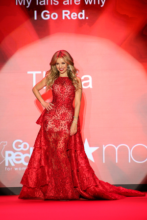 NEW YORK, NY - FEBRUARY 12: Singer Thalia walks the runway at the Go Red For Women Red Dress Collection 2015 presented by Macy's fashion show during MBFW Fall 2015 at Lincoln Center on February 12, 2015 in NYC 新聞圖片