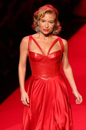 NEW YORK, NY - FEBRUARY 12: Tracy Anderson walks the runway at the Go Red For Women Red Dress Collection 2015 presented by Macy's fashion show during MBFW Fall 2015 at Lincoln Center on February 12, 2015 in NYC