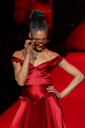 NEW YORK, NY - FEBRUARY 12: Carla Hall walks the runway at the Go Red For Women Red Dress Collection 2015 presented by Macy's fashion show during MBFW Fall 2015 at Lincoln Center on February 12, 2015 in NYC