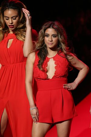 an ally: NEW YORK, NY - FEBRUARY 12: Dinah Jane Hansen and Ally Brooke (r) of Fifth Harmony walks the runway at the Go Red For Women Red Dress Collection 2015 show during MBFW Fall 2015 at Lincoln Center on February 12, 2015 in NYC