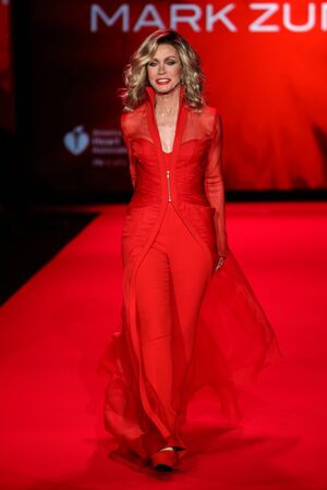 donna: NEW YORK, NY - FEBRUARY 12: Donna Mills walks the runway at the Go Red For Women Red Dress Collection 2015 presented by Macys fashion show during MBFW Fall 2015 at Lincoln Center on February 12, 2015 in NYC Editorial
