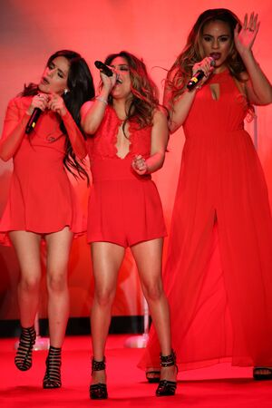 an ally: NEW YORK, NY - FEBRUARY 12: Fifth Harmony performs on the runway at the Go Red For Women Red Dress Collection 2015 presented by Macys fashion show during MBFW Fall 2015 at Lincoln Center on February 12, 2015 in NYC