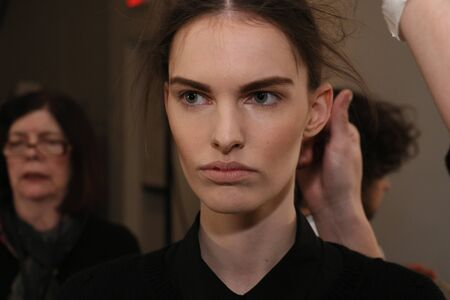 'getting ready': NEW YORK, NY - FEBRUARY 13: A model getting ready backstage at the Sally LaPointe Fashion show during MBFW Fall 2015 at Skylight Modern on February 13, 2015 in NYC. Editorial