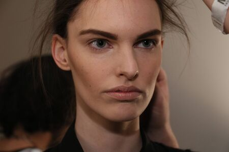 strong foundation: NEW YORK, NY - FEBRUARY 13: A model getting ready backstage at the Sally LaPointe Fashion show during MBFW Fall 2015 at Skylight Modern on February 13, 2015 in NYC. Editorial