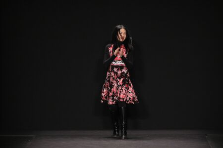 neoprene: NEW YORK, NY - FEBRUARY 16: Designer Vivienne Tam walks the runway at the Vivienne Tam fashion show during MBFW Fall 2015 on February 16, 2015 in NYC.