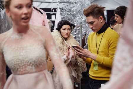 qui: NEW YORK, NY - FEBRUARY 19: Designer Ly Qui Khanh  and  models backstage at the New York Life  show during MBFW Fall 2015 at Lincoln Center on February 19, 2015 in NYC.