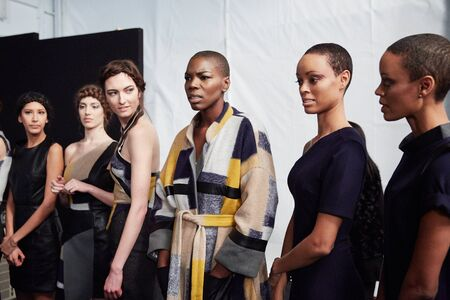 lineup: NEW YORK, NY - FEBRUARY 19: Models lineup backstage at the New York Life fashion show during MBFW Fall 2015 at Lincoln Center on February 19, 2015 in NYC.