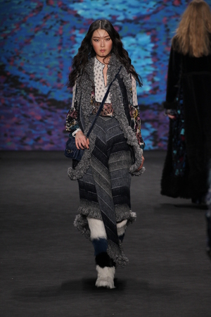 NEW YORK, NY - FEBRUARY 18: Model Sung Hee walks the runway at the Anna Sui fashion show during MBFW Fall 2015 at Lincoln Center on February 18, 2015 in NYC