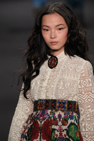wen: NEW YORK, NY - FEBRUARY 18: Model Xiao Wen Ju walks the runway at the Anna Sui fashion show during MBFW Fall 2015 at Lincoln Center on February 18, 2015 in NYC