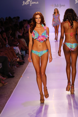 lycra: MIAMI, FL - JULY 20: A model walks the runway at the Luli Fama during MBFW Swim 2015 at The Raleigh hotel on July 20, 2014 in Miami, FL. Editorial