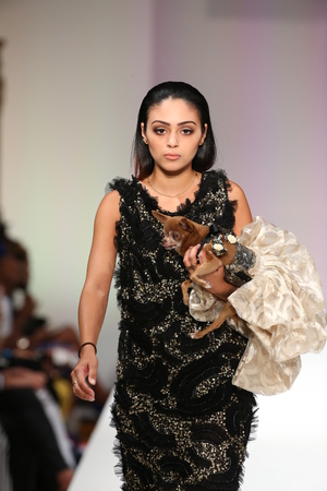 eveningwear: NEW YORK, NY - SEPTEMBER 12: A model walks the runway at the Anthony Rubio fashion show during Spring 2016 New York Fashion Week at Gotham Hall on September 12, 2015 in New York City.