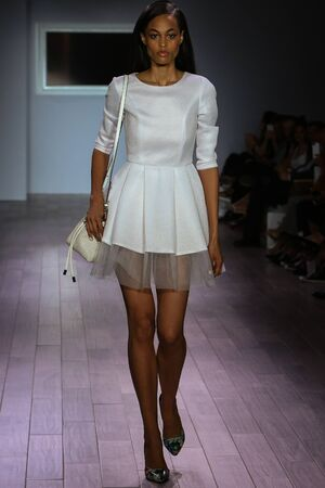 african american silhouette: NEW YORK, NY - SEPTEMBER 16: A model walks the runway at Raul Penaranda fashion show during New York Fashion Week Spring 2016 at Style 360 on September 16, 2015 in NYC.
