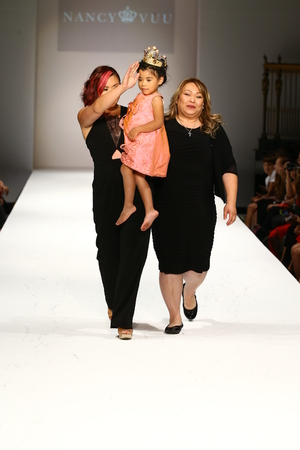 queen of angels: NEW YORK, NY - SEPTEMBER 10: Designer and her daughter walks the runway at the Nancy Vuu fashion show during Spring 2016 New York Fashion Week at Gotham Hall on September 10, 2015 in New York City.