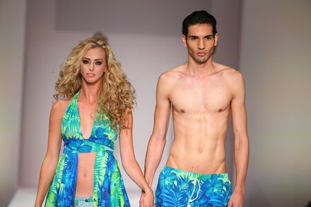 september 2: NEW YORK, NY - SEPTEMBER 11: Models walk the runway at the Lainy Gold Swimwear fashion show during Spring 2016 New York Fashion Week at Gotham Hall on September 11, 2015 in New York City.
