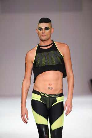 alumni: NEW YORK, NY - SEPTEMBER 12: Model Joshua Miller walks the runway at the Marco Marco fashion show during Spring 2016 New York Fashion Week at Gotham Hall on September 12, 2015 in NYC.