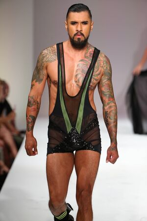 during: NEW YORK, NY - SEPTEMBER 12: Porn star extraordinaire Boomer Banks walks the runway at the Marco Marco fashion show during SS 2016 NYFW at Gotham Hall on September 12, 2015 in NYC, Editorial