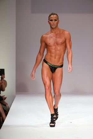 man ass: NEW YORK, NY - SEPTEMBER 12: Androgyny model Jason Wimberlywalks the runway at the Marco Marco fashion show during Spring 2016 New York Fashion Week at Gotham Hall on September 12, 2015 in New York City.