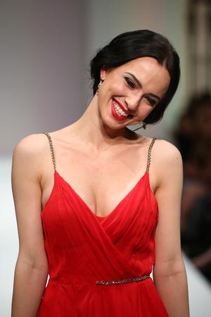 eveningwear: NEW YORK, NY - SEPTEMBER 11: Designer Christina Berezchneva walks the runway at the Crisberys fashion show during Spring 2016 New York Fashion Week at Gotham Hall on September 11, 2015 in NYC. Editorial