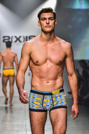 NEW YORK, NY - OCTOBER 14: Model walks the runway during 2(X)IST Men's Spring/Summer 2016 Runway Show at Skyline Modern on October 14, 2015 in NYC Editoriali