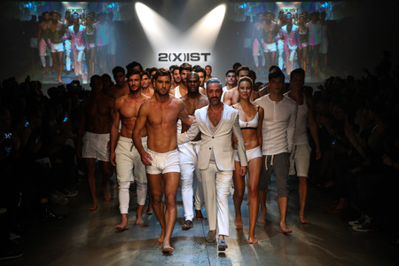 finale: NEW YORK, NY - OCTOBER 14: Designer  Jason Scarlatti and models walk the runway finale during 2(X)IST Mens SpringSummer 2016 Runway Show at Skyline Modern on October 14, 2015 in NYC.