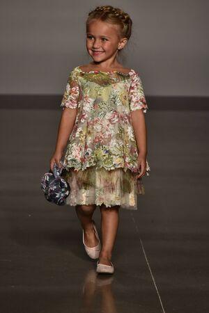 NEW YORK, NY - OCTOBER 17: A model walks runway at Olvis FallWinter 2016 Runway Show during petiteParade at The Spring Studio on October 17, 2015 in NYC. Editöryel