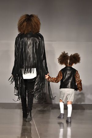 child model: NEW YORK, NY - OCTOBER 17: Mother and kid model walks runway at Laer FallWinter 2016 Runway Show during petiteParade at The Spring Studio on October 17, 2015 in NYC. Editorial