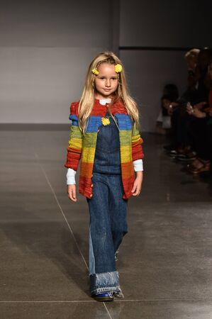 NEW YORK, NY - OCTOBER 17: A model walks runway at The New School Parsons FallWinter 2016 Runway Show during petiteParade at The Spring Studio on October 17, 2015 in NYC.