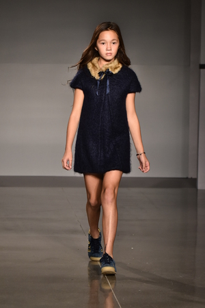 designer baby: NEW YORK, NY - OCTOBER 17: A model walks runway at The New School Parsons FallWinter 2016 Runway Show during petiteParade at The Spring Studio on October 17, 2015 in NYC.