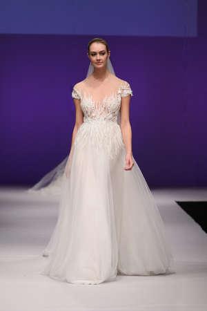 wedding dress silhouette: NEW YORK, NY - OCTOBER 10: A model walks at Lee Petra Grebenau Bridal FallWinter 2016 Runway Show at The Pier 94 on October 10, 2015 in New York City.