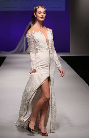 wedding dress silhouette: NEW YORK, NY - OCTOBER 10: A model walks at Orabella Bridal FallWinter 2016 Runway Show at The Pier 94 on October 10, 2015 in New York City. Editorial
