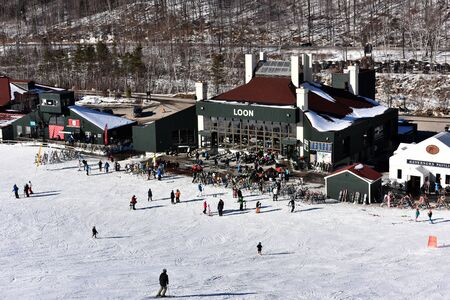 ski lodge: LOON MOUNTAIN USA - JANUARY 24: Tina Sutton Memorial - Slalom Ski Competition. Loon mountain lodge view from lift chair during junior ski race on January 24, 2016 at the Loon Mountain in NH, USA