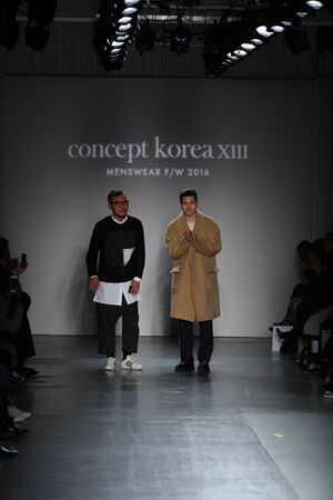 NEW YORK, NY - FEBRUARY 01: (L-R) DBYD designer Kang Dong Jun and Ordinary people designer Jang Hyeong Cheol walk the runway at the conclusion of Concept Korea during New York Fashion Week Men's Fall/Winter 2016 at Pier 59 Studios on February 1, 2016 in N 新闻类图片
