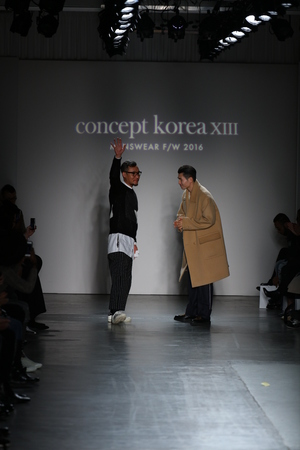 avant garde: NEW YORK, NY - FEBRUARY 01: (L-R) DBYD designer Kang Dong Jun and Ordinary people designer Jang Hyeong Cheol walk the runway at the conclusion of Concept Korea during New York Fashion Week Mens FallWinter 2016 at Pier 59 Studios on February 1, 2016 in N Editorial
