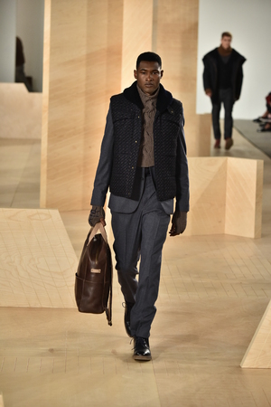 perry: NEW YORK, NY - FEBRUARY 03: A model walks the runway wearing Perry Ellis during New York Fashion Week Mens FallWinter 2016 on February 3, 2016 in NYC.