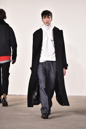topcoat: NEW YORK, NY - FEBRUARY 03: A model walks the runway at Tim Coppens fashion show during the New York Fashion Week Mens FallWinter 2016 at Skylight at Clarkson Sq on February 3, 2016 in NYC