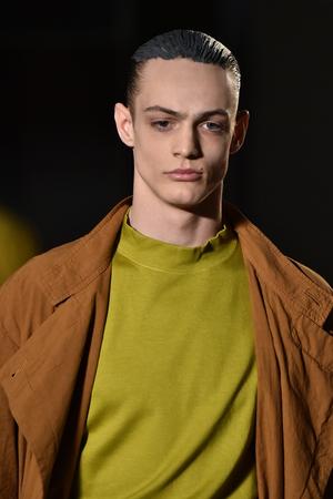 robert: NEW YORK, NY - FEBRUARY 02: A model walks the runway wearing Robert Geller during New York Fashion Week Mens FallWinter 2016 on February 2, 2016 in NYC. Editorial