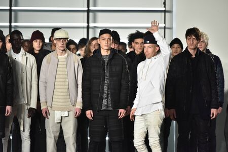 elliot: NEW YORK, NY - FEBRUARY 04: Designer John Elliot (C white) comes out with his models at the conclusion of the John Elliott + CO New York Fashion Week Mens FallWinter 2016 on February 4, 2016 in NYC.